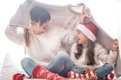 Christmas concept, mom and her daughter playing stock photo
