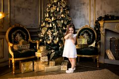 Christmas concept. New Year. Children dress up a Christmas tree. Kids and Christmas toys royalty free stock photo