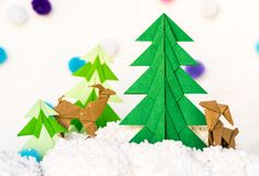 Reindeer and fir tree origami paper craft Royalty Free Stock Photography