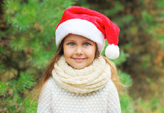 Christmas concept - portrait little girl child in santa red hat Royalty Free Stock Images