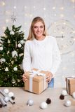 Christmas concept - portrait of young beautiful blond woman with royalty free stock images
