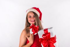 Christmas concept. Pretty girl wearing red dress holding present gift box Stock Photography