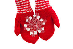 Christmas concept Red mittens with toy snowflake on a white background Stock Photo