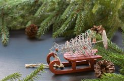 Christmas concept with red sleigh, pine cones and fir tree branch on black background.Copy space. Christmas concept with red sleigh, pine cones and fir tree Stock Images