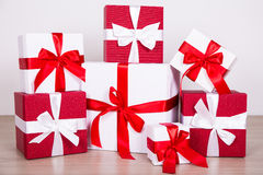 Christmas concept - red and white gift boxes on wooden floor Stock Photo