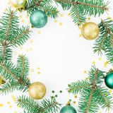Christmas concept. Round frame of fir branches, glass balls and golden confetti on white background. Flat lay, top view. Christmas concept. Round frame of fir stock image