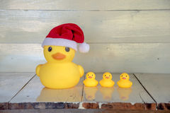 Free Christmas Concept, Rubber Yellow Duck Wear Santa Clause Hat Stock Photo - 63459240