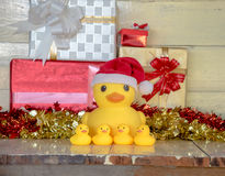 Christmas concept, rubber yellow duck wear  Santa clause hat Stock Photos
