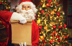 Christmas concept. Santa Claus and blank list Royalty Free Stock Images