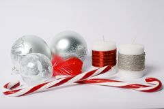 Christmas concept - silver christmas balls, candy-sticks and dec royalty free stock photo