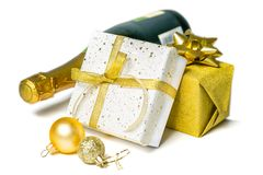 Christmas concept - silver and gold presents with champagne and balls. Isolated on white, copy space royalty free stock images