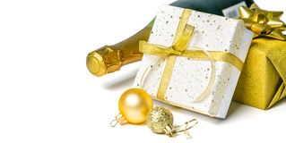 Christmas concept - silver and gold presents with champagne and balls. Isolated on white, copy space royalty free stock image