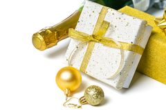 Christmas concept - silver and gold presents with champagne and balls. Isolated on white, copy space stock photos