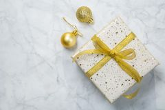 Christmas concept - silver and gold presents with confetti and ribbon royalty free stock photos