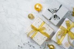 Christmas concept - silver and gold presents with confetti and ribbon stock photos