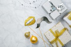 Christmas concept - silver and gold presents with confetti and ribbon royalty free stock photo