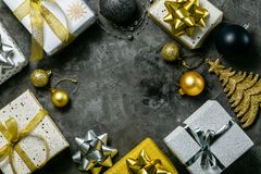 Christmas concept - silver and gold presents with confetti and ribbon stock photo