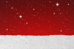 Christmas concept snow falling and stars on a background Stock Images