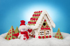Christmas concept. Snowman, Christmas trees and gingerbread hous Royalty Free Stock Photo