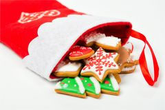Christmas concept. Christmas sock with gingerbread on white back Royalty Free Stock Photo