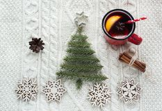 Christmas concept with spruce, fir-tree, cone and mulled wine on white knitted background. Holiday card. Stock Images