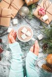 Girl hand with Christmas gifts and hot chocolate Stock Photography
