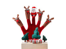 Christmas concept toy Santa Claus and reindeer with gifts on hand Stock Photo