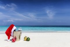 Christmas concept on a tropical beach for the festive holiday season royalty free stock images
