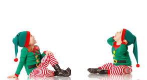 Christmas concept two children cheerful elf looking upisolated. Christmas concept two children cheerful elf looking up isolated on white background Royalty Free Stock Photo