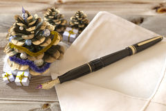 Christmas cone with gifts,pen and letter. Greetings holiday concept Stock Photography