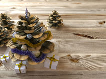 Christmas cone with gifts on wood texture Stock Photos