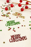 Christmas confetti red berries decoration table Royalty Free Stock Photo