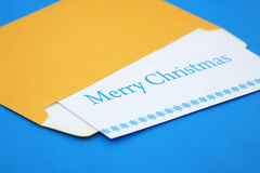 Christmas congratulation. Christmas letter with congratulations and snowflakes in an envelope on a dark blue background Stock Images