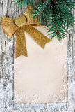 Christmas congratulation card with golden bow Stock Image