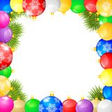 Christmas congratulations frame. With multicolored balls and fir branches Royalty Free Stock Photos