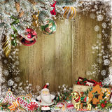 Christmas congratulatory background with pine branches, candy, Santa Claus and Christmas decorations. Pine branches, Christmas decorations, sweets, Santa Claus Stock Photography