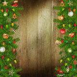 Christmas congratulatory background with pine branches and Christmas ornaments on the wooden background Stock Photo