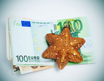 Christmas consumerism. A christmas star with euro bills symbolizing the concept christmas consumerism Stock Image