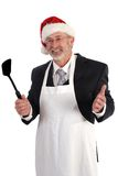 Christmas cook. Senior Businessman volunteering at Christmas Stock Image