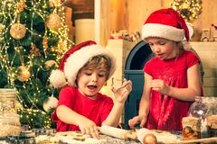 Free Christmas Cookery. Children Cooking For Christmas. Thanksgiving Day And Christmas For Children. Children Are Cooking Royalty Free Stock Photography - 174203367
