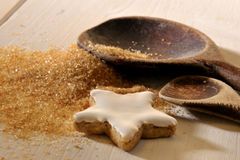 Christmas cookie. Tow wooden spoons and brown sugar on a table Royalty Free Stock Images