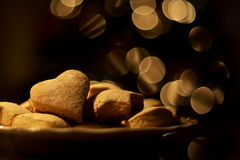 Christmas cookie with bokeh. Heart shaped shortbread cookies with bokeh Stock Photos