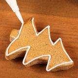 Christmas cookie. Close-up of pipping bag and gingerbread cookie royalty free stock photography
