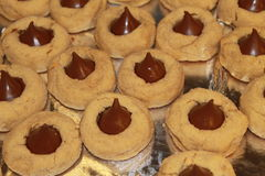 Christmas Cookie Close-Up. A close-up professional shot of the peanut butter and chocolate Hershey kiss cookies known as Peanut Butter Blossoms Royalty Free Stock Photography
