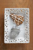 Christmas cookie and a cookie cutter Royalty Free Stock Images