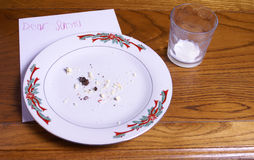Christmas Cookie Crumbs and Santa Note Stock Photos