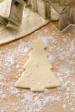 Christmas cookie cutter.Christmas tree shape. Christmas cookie cutter. Christmas tree shape and uncooked biscuit Royalty Free Stock Images