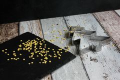 Christmas cookie cutter christmas tree and yellow sugar stars on wooden table stock images