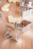 Christmas Cookie Cutters. Christmas cookies and cutters on a wooden surface Stock Images