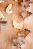 Christmas Cookie Cutters. Christmas cookies and cutters on a wooden surface Royalty Free Stock Photos